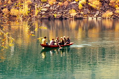 Boating In Lake Upper Kachura (Amir Mukhtar Mughal | www.amirmukhtar.com) Tags: trip autumn trees friends red people lake reflection water leaves yellow canon landscape golden boat stones group scenic enjoy amir boating rowing ripples mughal mughals skardu lakeupperkachura amirmukhtar