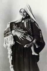 Woman and child - Khalil Raad - 1920 (intasko) Tags: life old family portrait bw lebanon woman baby history beautiful beauty smile face vintage mom freedom israel photo nice pretty child dress faces emotion affection humanity robe palestine femme traditional oppression dream mother hijab culture documentary kind story vision photograph arab syria jewish lovely delicate sourire injustice vie liban ancienne ancien palestina catastrophe palestinian occupation nakba siecle sourrire palestinien tmoignage khalilraad palestienne