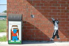 The Toss (fleepaint) Tags: street streetart art trash graffiti kid garbage stencil paint can spray bin recycle aerosol throwing rubish