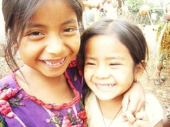 Two girls smiling in the coffee field.