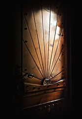 what's behind...? (Violen's photography) Tags: door wood old light shadow dark wooden poland polska imagination behind ornate bukowinatatrzanska bukowinatatrzaska fantasty
