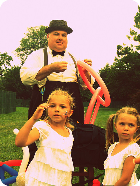 a balloon maker and girls