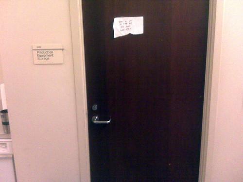 Door with makeshift sign