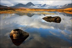 Waiting for the light - Rannoch Moor (David Hannah) Tags: autumn light sky mountains fall water clouds canon reeds scotland rocks sigma highland moor autumnal rannoch 40d impressedbeauty