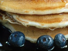 Never work before breakfast; if you have to work before breakfast, eat your breakfast first.  - Josh Billings (OneEyedJax) Tags: blue fruit pancakes breakfast stack pile hotcakes blueberries comfortfood flapjacks omot