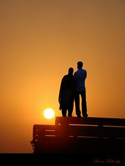 Lovebirds.... (aroon_kalandy) Tags: light sunset sea sky orange sun india seascape art love beach nature water beautiful beauty silhouette yellow photoshop wonderful landscape creativity photography lights golden evening landscapes photo twilight couple photographer adobephotoshop artistic sony awesome creative kerala romance fantasy stunning greatshot orangesky impressions concept lovely lightpainter naturelovers calicut kozhikode sihloutte supershot bestlandscape topshots beautifulshot anawesomeshot theperfectphotographer malayalikkoottam worldwidelandscapes thesuperbmasterpiece worldwidelandscape sonyh50 100commentgroup artisticmode aroonkalandy peopleenjoyingnature