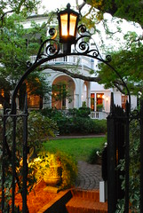 Through the Garden Gate (StGrundy) Tags: usa history home lamp architecture night garden evening twilight nikon gate unitedstates south wroughtiron southcarolina historic charleston explore southern burning coastal historical gaslight lowcountry explored d80 exposure08sec focallength26mm nikkor1855mmf3556gvr aperturef160