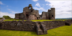 Rhuddlan Castle and Moat (Etrusia UK) Tags: uk greatbritain sky castle history castles wales clouds buildings geotagged nikon ruins britishisles unitedkingdom fort britain stonework wideangle gb walls 1020mm monuments moat fortress pictureperfect denbighshire cadw welshcastles ultrawideangle sigmalens rhuddlancastle 1020mmlens sigma1020mmlens royalcastles grassandplants geo:lat=532898610632 geo:lon=346484485785