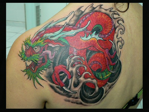 Crazy dragon, done by Mr. Red Dog Tattoo in Benalmádena.