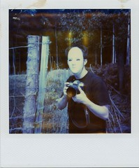 he came from the wood... (Knee Bee) Tags: camera wood man fence polaroid mask shock expired sx70film