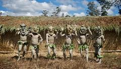 Mud Men (Dave Schreier) Tags: new blue sky tree men grass leaves guinea mask mud hut tribe papua