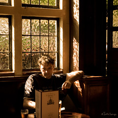 the sketcher (moggierocket) Tags: wood old uk sunlight guy london window corner table pub nikon alone shadows drawing interior patterns sketching victorian drinking thecity ripples d200 hopper oneperson 1875 havingadrink theblackfriar
