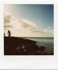 searching the world (Ouendi) Tags: sea film silhouette polaroid sx70 mauritius polaroid600 northcoast ndfilter pereybere ilemaurice panpola roidweek2009