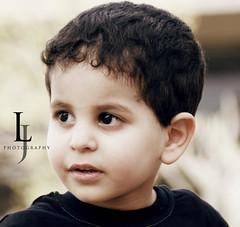 Faisal (- Lulwa) Tags: boy baby black cute face look yellow photography little sony lj cousin alpha a200 faisal stylishloolita