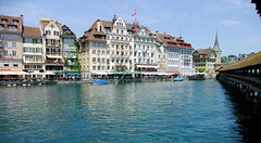 Waterfront Buildings (cwgoodroe) Tags: sun mountain lake snow alps green church statue ferry fairytale swimming switzerland boat europe locals suisse swiss sunny location farms movieset luce swissalps lucern medivil beerpasture