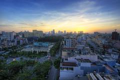 Sunrise over Saigon (jovene) Tags: city trip travel sea vacation sky cloud holiday sunrise canon hotel asia southeastasia vietnamese vietnam saigon hochiminhcity hdr asean hcmc asiapacific elios 400d