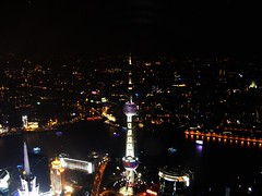 View of Shanghai and Oriental Pearl  form the top of the World Financial Centre bulding (Rincewind42) Tags: china urban tower night dark landscape evening cityscape shanghai nighttime pearl   oriental pudong 2009 orientalpearltower orientalpearl