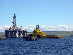 Tugs moving an oil rig near in Invergorden