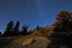 Trails Over Vedauwoo (Fort Photo) Tags: camping trees sky tree nature silhouette rock night forest way stars landscape star nikon rocks nightscape trails boulder astrophotography granite astronomy wyoming milky 2009 afterdark polaris milkyway northstar d300 vedauwoo circumpolar tokina1116