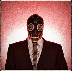 Mask? What mask? ('PixelPlacebo') Tags: red toxic shirt insect mask tie gas business suit panic future gasmask backlit swine bomb atomic flu banker strobes 500x500 pandemia strobist atomar greenit panicmode