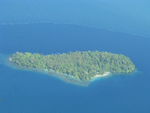Island and boat in Madang Province