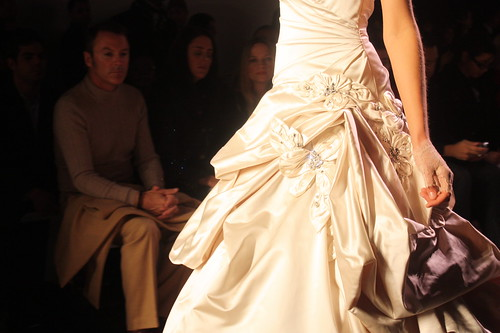 Here is Colin Cowie looking pensive as he contemplates a gown at Monique