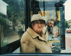 Busted at the bus stop (x 4) (deepstoat) Tags: street colour bus london film zeiss 35mm yashicat5 busted minime austinpowers onemilliondollars drevil mikemeyers autaut deepstoat streetphotographycandidstreetportrait