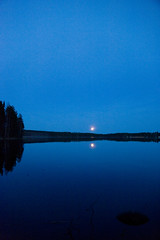 Moon rising over Sksjrvi (Rd. Vortex) Tags: blue moon lake night spring nikon calm tamron jyvskyl 2875 keljonkangas d700