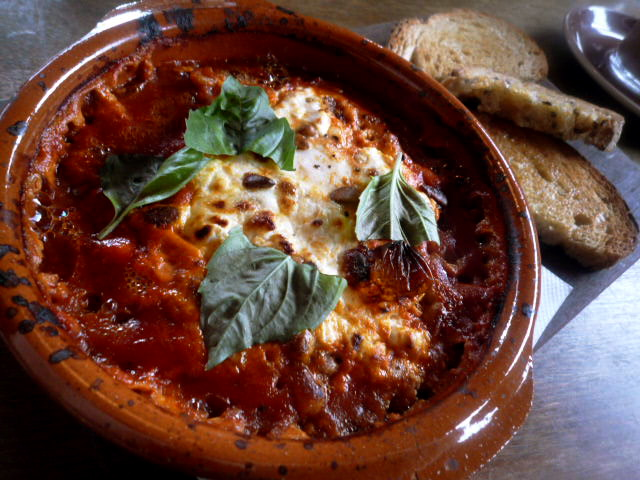 Free range eggs baked in napoli sauce with goats cheese, basil, pine nuts and toast