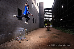 (r c hill photography) Tags: street white man black art wall shopping jump gallery shot theatre trolley free running run trainers setup milton keynes parkour strobist