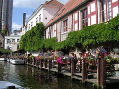 Boating by Bruges. (davidezartz) Tags: city travel pink flowers blue windows light red sky people brown white black green water sunshine yellow architecture clouds buildings reflections boats grey boat nikon europe tour shadows purple belgium belgique ships brugge ivy canals boating romantic bruges charming 1001nights brava merchant hedera middleages allowed twop e3100 theworldwelivein nikone3100 topshots flickrsbest passionphotography nikonstunninggallery golddragon anawesomeshot diamondclassphotographer flickrdiamond ysplix platinumheartaward theperfectphotographer goldstaraward flickrestrellas quarzoespecial theenchantedcarousel panoramafotografico passionateinspirations dragondaggeraward saariysqualitypictures platinumbestshot travelsofhomerodyssey flickrvault boatingbybruges 1001nightsmagiccity