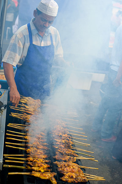 Grilling chicken at an evening market on the eve of Aidilfitri, Kota Bharu, Malaysia