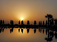 sunrise over the swimming pool (coxy2001) Tags: sunrise egypt panasonic taba breathtakinggoldaward dmcfz28 breathtakinghalloffame mygearandmepremium mygearandmebronze mygearandmesilver mygearandmegold mygearandmeplatinum mygearandmediamond