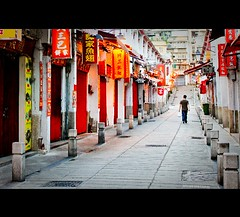 Asia | Macau: Rua da Felicidade~ (Vu Pham in Vietnam) Tags: china street morning travel red male tourism portugal sign shop architecture restaurant design early movement asia southeastasia peace walk candid chinese culture streetphotography felicidade peaceful  dailylife macau hue vu portuguese 2009 macao   500d  canon500d  lingnam happiness street dulch phc trungquc ngph ruadafelicidade trunghoa conngi sanvahotel raininvietnam commentwithimageswillbedeletedsosorryforthis tranquiltity