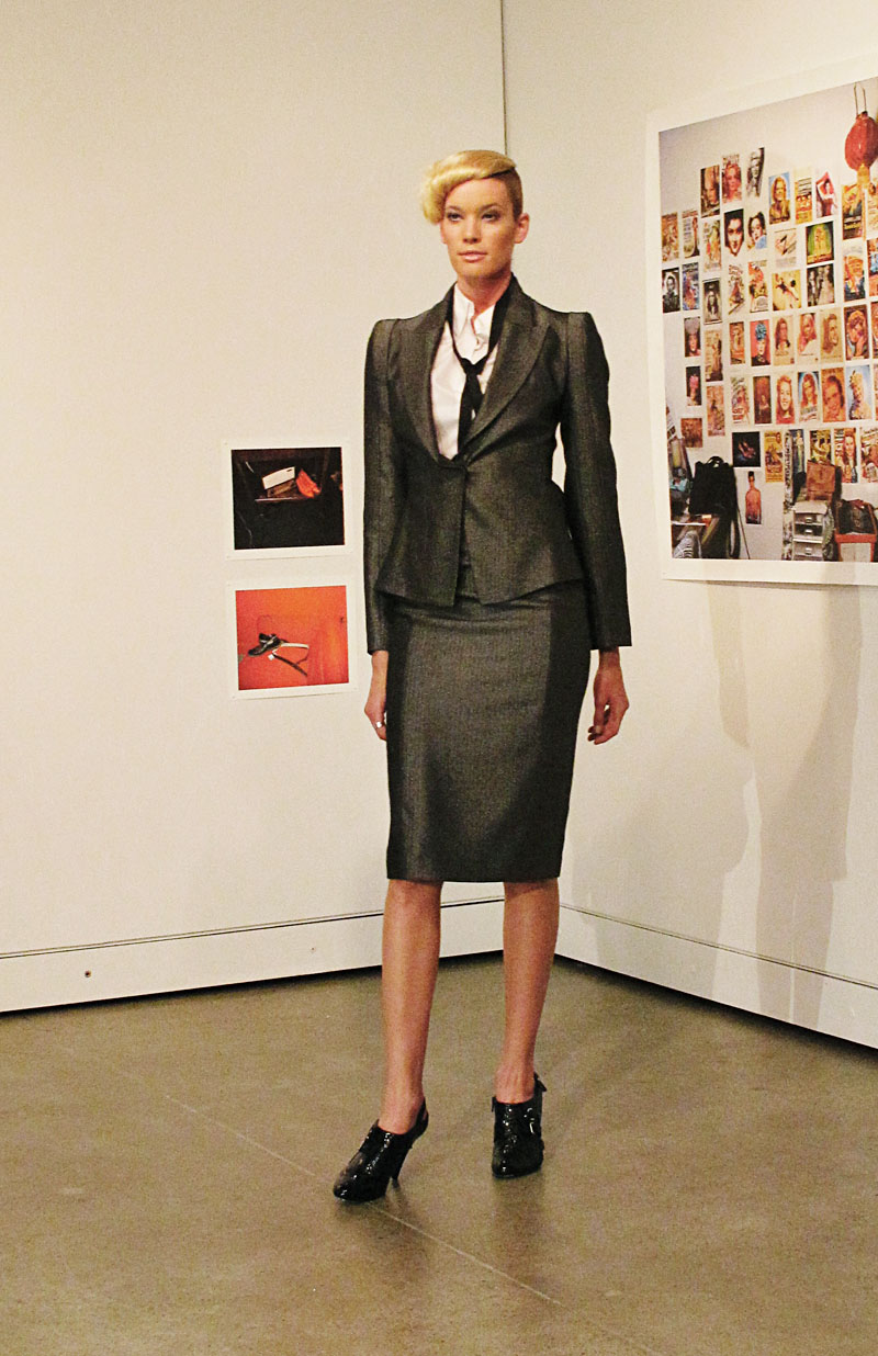 Carl Kapp Grey tailored skirt and jacket with white blouse and narrow black tie loosely worn. Very Helmut Newton! AW10