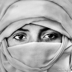 Veiled Tuareg Young Man ! (Bashar Shglila) Tags: white man black sahara eyes veil desert young libya tuareg libyen urbanblackandwhite lbia libi libiya liviya ghadamis libija  tagelmust  updatecollection    lbija  lby libja lbya liiba livi