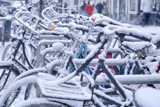 Snow flurries falling down and swirling around bikes