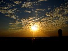 fall's sunset day (ana ono) Tags: brazil sky woman girl azul brasil mxico photography ana necklace bottle warm heart paisagem cu piercing nuvens corao vista janela windowview colar garrafa coracion ono pingente subexposio clows