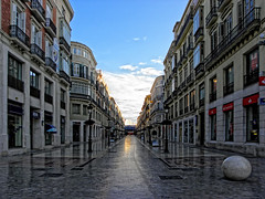 Calle Larios a las 08:00 (ToniMolero07) Tags: blue sky espaa azul clouds buildings andaluca spain edificios ground shades reflected cielo nubes andalusia sombras mlaga reflejos suelo watered callelarios inspiredbylove regada ultimateshot goldstaraward yourcountry tonimolero