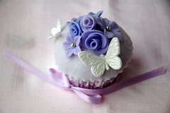 Bride's special wedding cupcake (creativecupcakes) Tags: wedding roses white silver airplane groom bride purple blossoms lavender butterflies cupcake fondant dragees