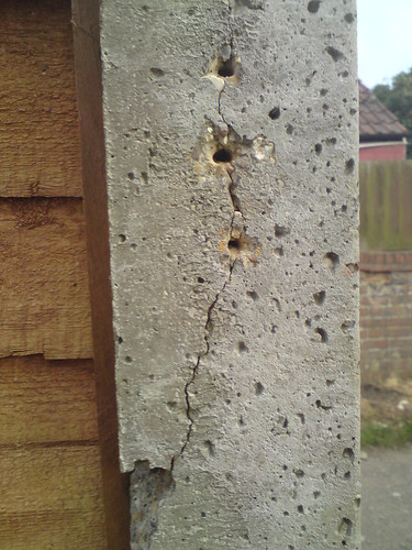 how to fix leaning wooden fence post