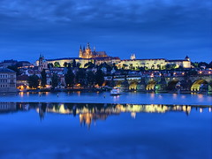 Prague Castle Blue Hour (Mike G. K.) Tags: longexposure bridge blue sky reflection castle church water architecture night buildings reflections river geotagged lights evening boat view prague cathedral praha medieval explore czechrepublic bluehour charlesbridge vltava dri hdr hdri blueribbon blending karlovmost praguecastle 15sec saintvitus exposureblending photomatix explored 3exp geo:lat=50084436 geo:lon=14413419 saariysqualitypictures mikegk:gettyimages=submitted