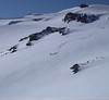 A snowboarder lays a fresh line at Termas de Chillan