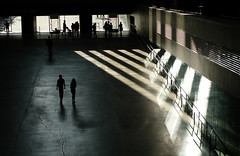 Geometry of the light (Che-burashka) Tags: light shadow urban london art lines museum architecture triangles hall triangle couple shadows geometry citylife silhouettes tatemodern turbinehall crack leisure gettys vents capitalcities playoflight lx3 crackinthefloor urbanlyric walkinginthelight gettyskn welcomeuk