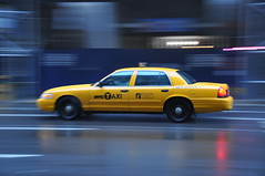 Yellow Cab (Explored!) (JRT ) Tags: door holiday newyork hot reflection wet rain sign nikon doors wheels yellowcab fast blured humid whitelines d90 thegalaxy 250minfare mygearandmepremium mygearandmebronze mygearandmesilver mygearandmegold mygearandmeplatinum mygearandmediamond johnwarwood flickrjrt photographyforrecreationclassic