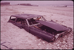 Sand Covers Abandoned Car on Beach at Breezy Point South of Jamaica Bay 05/1973 (The U.S. National Archives) Tags: newyorkcity newyork abandoned plymouth queens stationwagon jamaicabay breezypoint abandonedcar environmentalprotectionagency valliant documerica gatewaynationalrecreationalarea usnationalarchives nara:arcid=547923