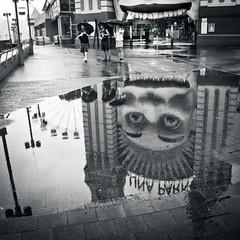 Luna Park in the Puddle (verorev) Tags: bw reflection rain puddle pavement sydney australia lunapark