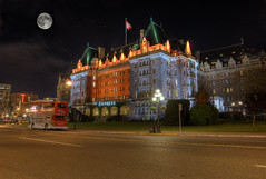 The Empress Hotel at Night (HDR) (Brandon Godfrey) Tags: world pictures lighting street city longexposure autumn urban moon canada streets building bus fall colors night landscape photography lights scenery colorful long exposure colours bc photos pics earth britishcolumbia sony ivy scene victoria canadian double fullmoon clear vancouverisland pacificnorthwest northamerica government colourful alpha dslr 2009 hdr highdynamicrange innerharbour decker theempress a300 fairmontempress photomatix theempresshotel tonemapped tonemapping sonya300