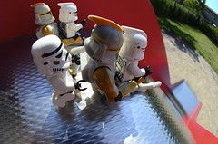 Out playing, going down the slide (Kalexanderson) Tags: red stilllife playing playground toys parents starwars lego outdoor sunny son slide troopers fisheye stormtrooper fatherandson clone clon clonewars leker lekplats familylife ordinarylife kloner abouttoslide spanga akarutschkana stormtrooperandson