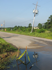 In the wet heat of a poorly-drained suburban morning in southwestern Louisiana. (Tim Kiser) Tags: 2014 20140713 acadiana calcasieuparish calcasieuparishlouisiana crackerbarrel crackerbarrelsign dennisavenue img5497 july july2014 lakecharlesmetropolitanarea louisiana louisianalandscape louisianastreetscape motel6 studio6 sulphur sulphurlouisiana sulphurlandscape sulphurstreetscape cautiontape cloudlesssky concretepavement dirtywater distantsigns electriclines electricpole landscape leaningelectricpole leaningutilitypole mudpuddle nosidewalk paved pavement polemountedtransformers poordrainage poorlydrained powerlines puddle reflectioninwater road southwestlouisiana southwesternlouisiana stagnantwater stakes standingwater street streetscape sunnyday transformers utilitypole view waterreflections wetpavement woodenstakes yellowcautiontape unitedstates